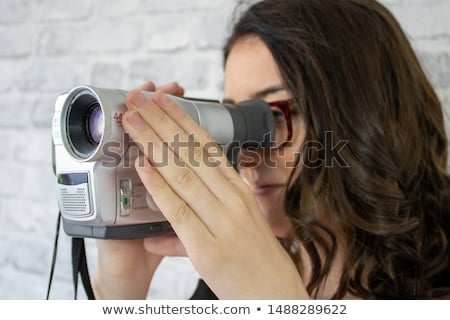 Woman with camcorder Stock photo © fahrner