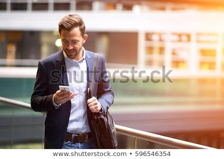 笑みを浮かべて 小さな ビジネスマン 携帯 会話 携帯電話 ストックフォト © aladin66