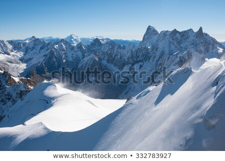 Mont-Blanc and rock and ice and sky blue Stock photo © mariephoto