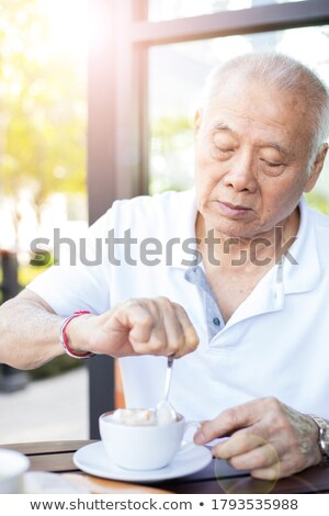 Senior man with an expresso Stock photo © photography33