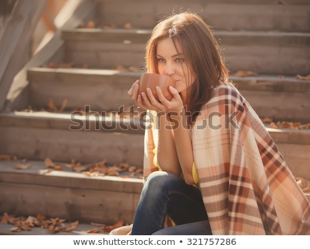 brunette drinking warm beverage Stock photo © photography33