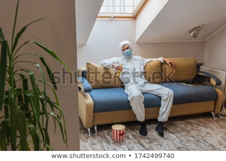 Man in protective suit near green plant Stock photo © pzaxe