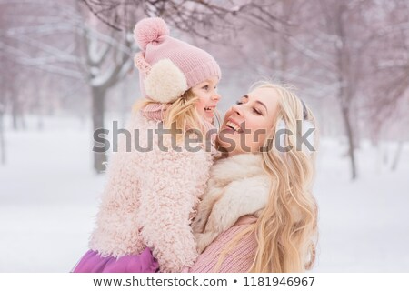 blonde in boots, fur and headphones Stock photo © dolgachov