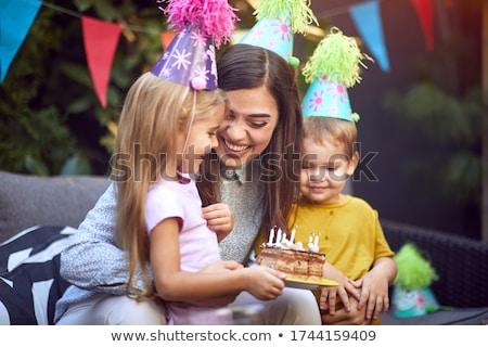 little girl playing with her birthday gifts . happy birthday card Stock photo © balasoiu
