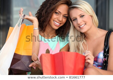girls in shopping frenzy Stock photo © photography33