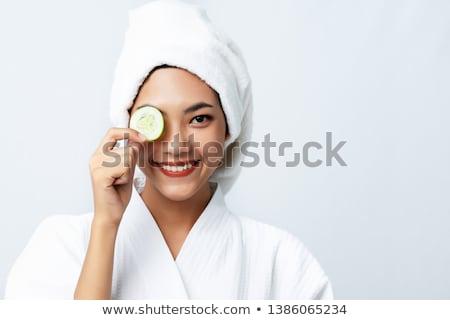 Woman with cucumber eye mask Stock photo © stryjek