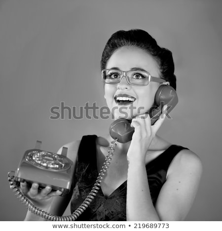 young girl using an old fashioned black telephone stock photo © photography33