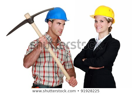 Builder aiming his pickaxe at a smiling architect Stock photo © photography33