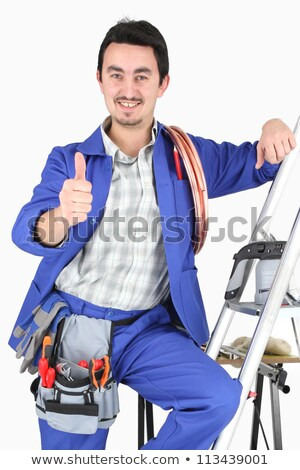 plumber with all his equipment making a thumbs up sign stock photo © photography33