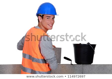 Young mason happily working away Stock photo © photography33