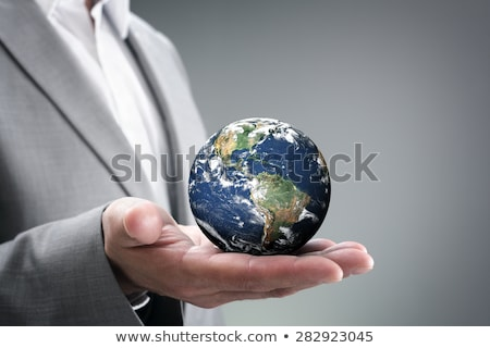 hand holding globe to protect the fragile environment Stock photo © arcoss