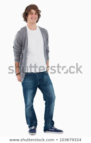 Smiling male student posing hands in the rear pockets against white background Stock photo © wavebreak_media