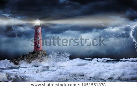 Faro noche océano luna rocas estrellas Foto stock © dinozzaver