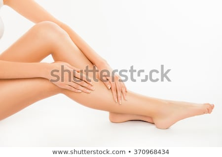 woman touches her leg by hand stock photo © nobilior