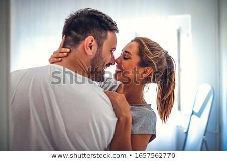 Boldog romantikus pár meghitt átölel fehérnemű Stock fotó © stryjek