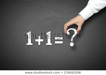 Zdjęcia stock: Businessman Holding Blackboard With Question Marks
