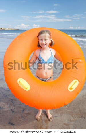 Child on beach with giant rubber ring Stock photo © monkey_business