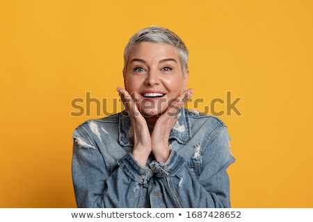 Mature woman standing with her hand on chin Stock photo © bmonteny