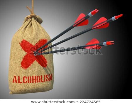 Alcoholism- Arrows Hit in Red Mark Target. Stock photo © tashatuvango