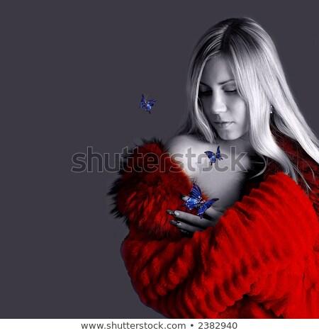 attractive delicate blonde playing with butterflies stock photo © konradbak