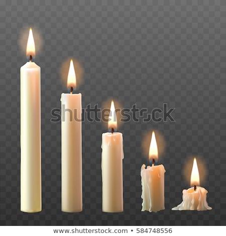 A white burning candle Stock photo © olandsfokus