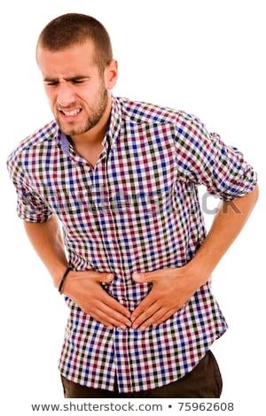 Moço forte estômago dor dor de estômago homem Foto stock © stockyimages