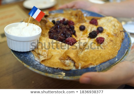 Folded pancakes with vanilla and raspberry sauce Stock photo © raphotos