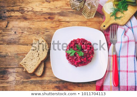 plate of beet salad with green towel Stock photo © philipimage