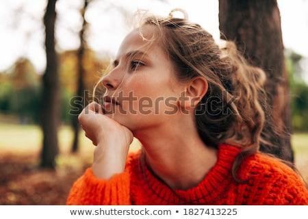 pensativo · jóvenes · mujer - foto stock © deandrobot