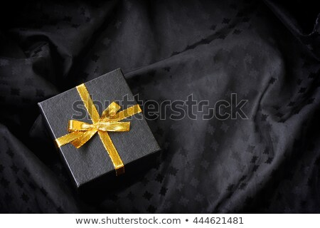 Black gift box with yellow satin ribbon and bow Stock photo © ozaiachin