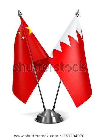 Kína Bahrein miniatűr zászlók izolált fehér Stock fotó © tashatuvango
