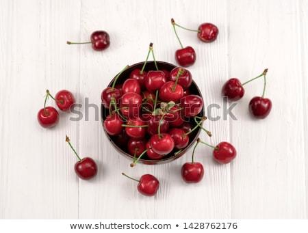 cherries in wooden bowl stock photo © oleksandro