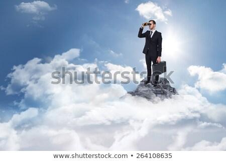 Empresário binóculo branco homem tecnologia caderno Foto stock © wavebreak_media
