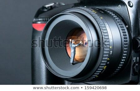Miniature man and camera. Macro photo Stock photo © master1305