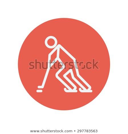 hockey player pushing the puck thin line icon stock photo © rastudio
