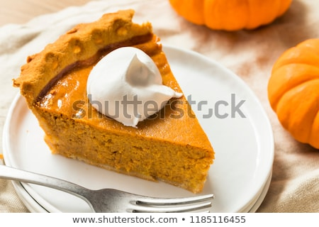 Pumpkin pie slice with whipped cream. Stock photo © rojoimages