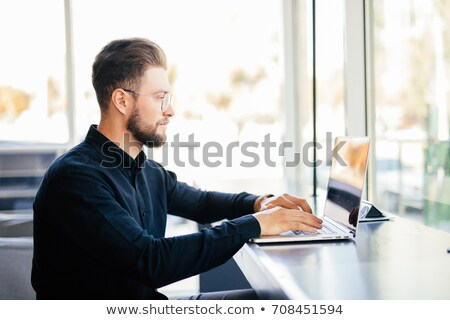 Side view Elderly business man by the table with partners Stock photo © deandrobot