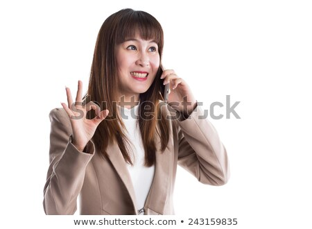 portrait of smiling businesswoman talking on smartphone in office stock photo © lightfieldstudios