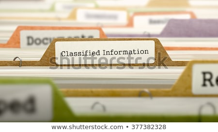 Folder in Catalog Marked as Classified Information. Stock photo © tashatuvango