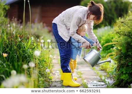 женщину ребенка лейка семьи девушки будущем Сток-фото © IS2
