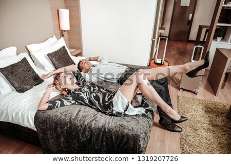a tired business couple in bed stock photo © is2