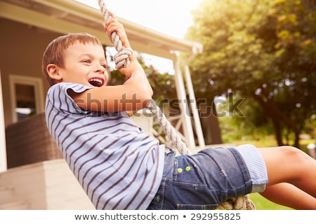 Young boy on swing Stock photo © IS2