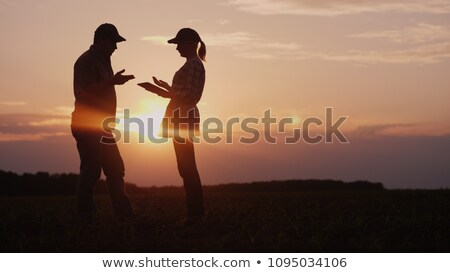 business woman talking to farmer stock photo © is2