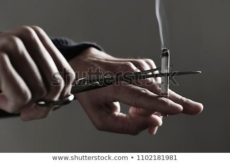 Hombre cigarrillo tijeras primer plano jóvenes Foto stock © nito