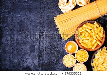 Assortment of different shape pastas on wooden background Stock photo © Valeriy