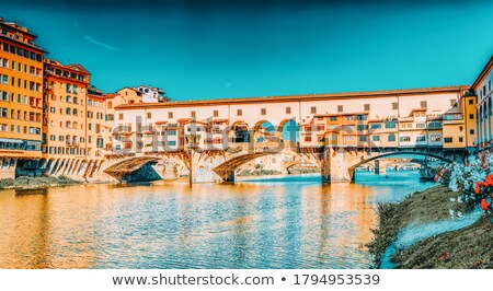Arno river waterfront morning reflections in Florence Stock photo © xbrchx