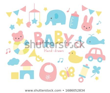 happy baby girl with toy blocks at birthday party Stock photo © dolgachov
