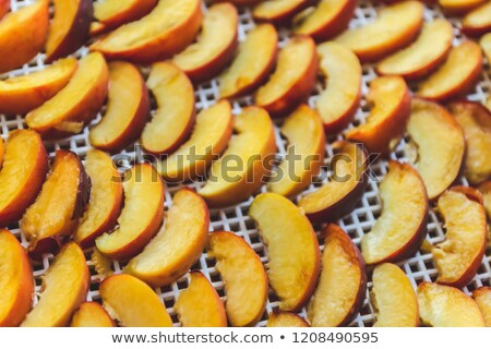 Peaches dried in a dehydrator dryer. A way to preserve vitamins. Stock photo © TanaCh