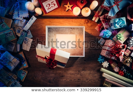 christmas gift boxes on wooden desk stock photo © choreograph