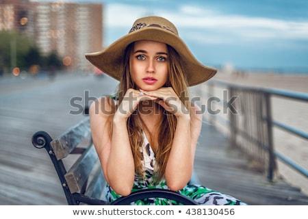 mosolygó · nő · ül · beszél · mobiltelefon · pad · mosolyog - stock fotó © deandrobot